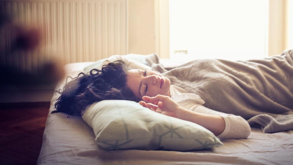 Sleep and beauty. Young sleepy woman in bed.