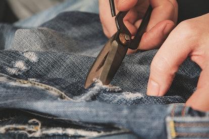 Denim repair. Blue jeans. Vintage style. Stock image.