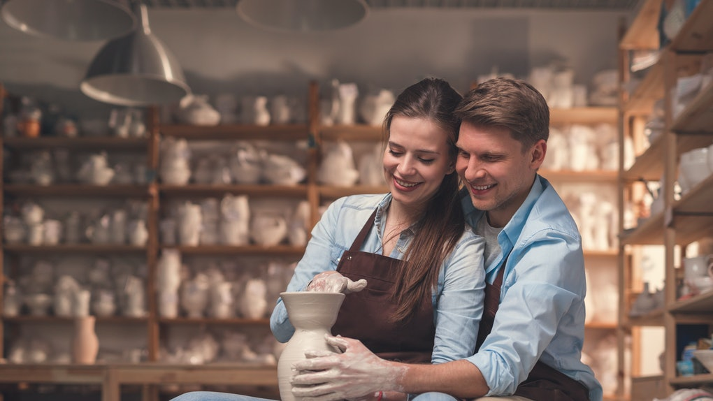 Young couple on a romantic date in pottery