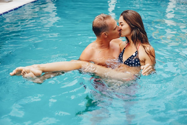 Couple in a swim suits. Two peaple in the pool