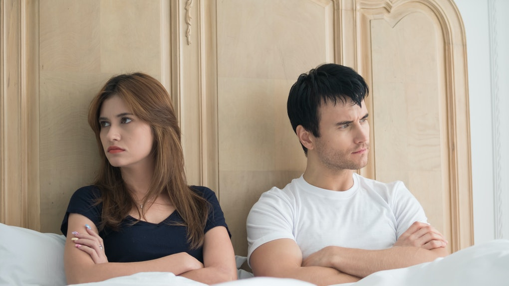 Upset young couple having problems in bedroom. Unhappy, upset, negative emotions concept.