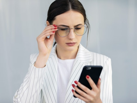 Business Woman Using Phone Near Office