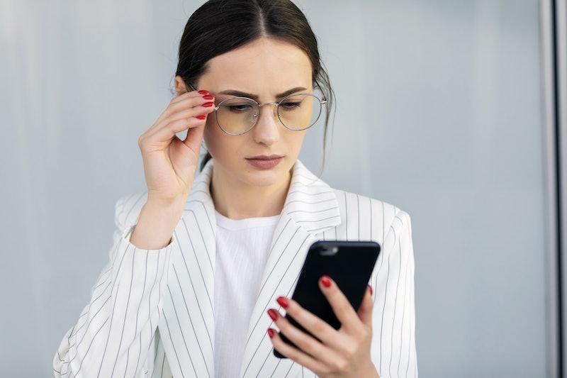 Business Woman Using Phone Near Office