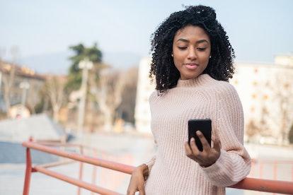Black afro-american woman using mobile phone