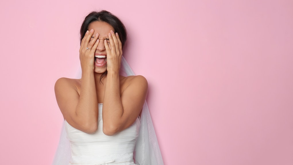 Screaming young bride on color background