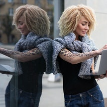 european hipster girl with tattoo on her hand and afro hairstyle work on laptop on street, in fresh ...