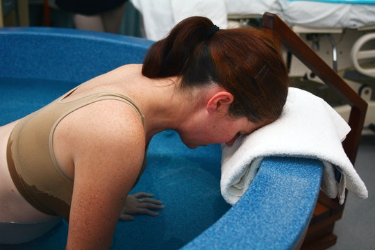 Pregnant woman during natural water birth.