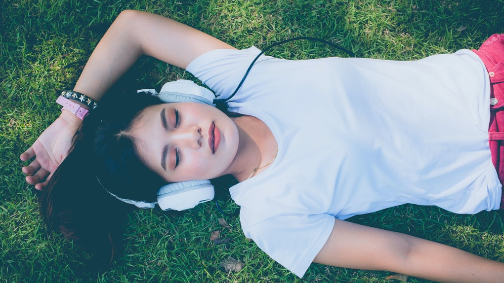 Women in music headphones pretty grass happy holidays.