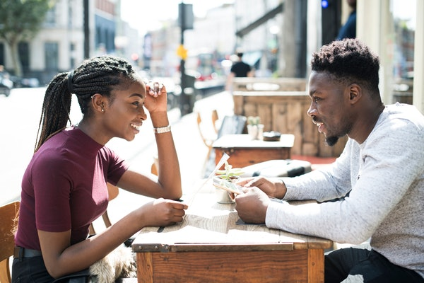 Couple reading the menu at a cafe