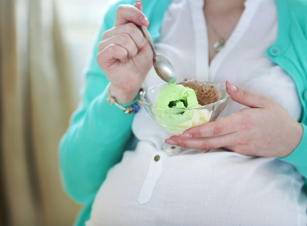 Pregnant woman with ice cream. Close up