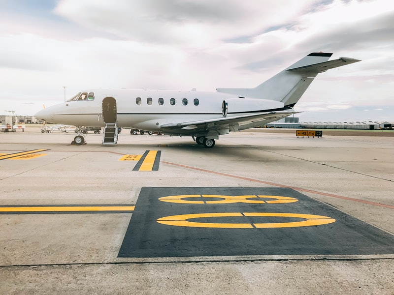 Private luxury jet at the airport terminal runway