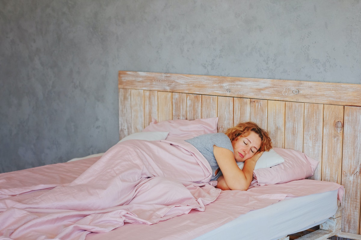 Insomnia in women during menopause / Overwork and early ascents/ Middle-aged woman sleeping asleep i...
