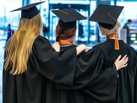 Graduates students. Students group. Graduates of a prestigious university. Student edition. Higher education.