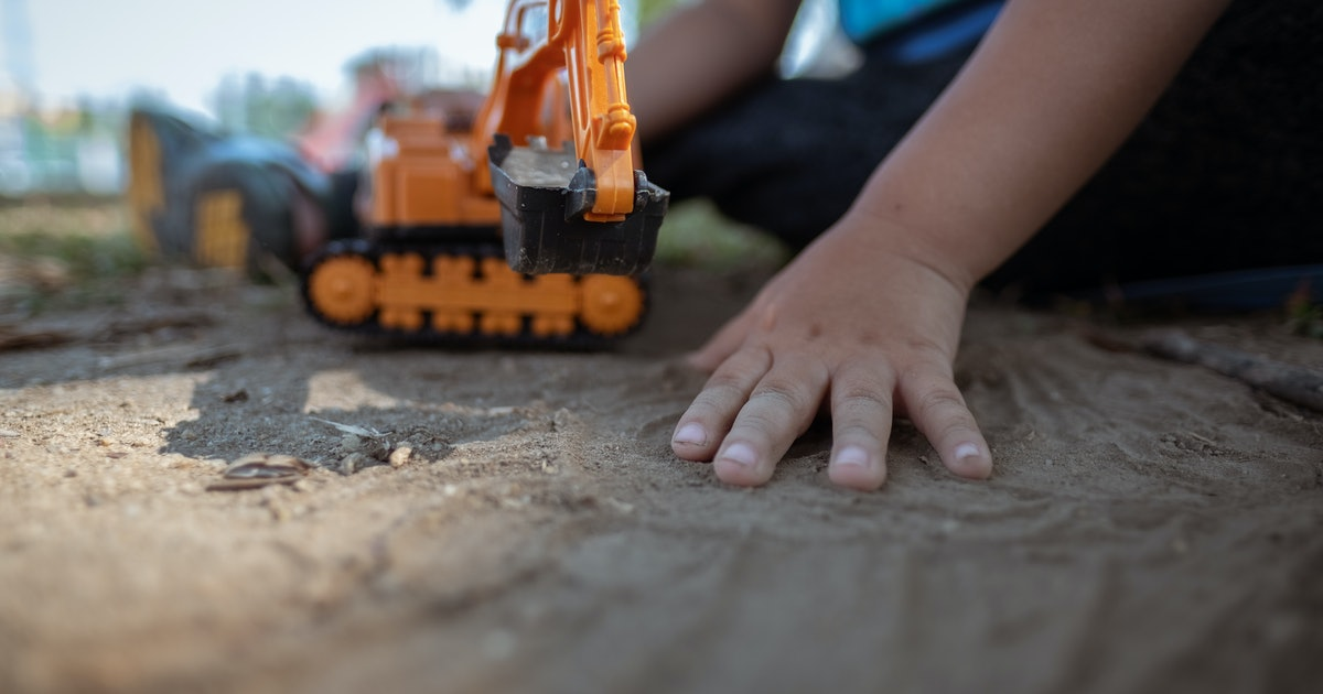 What Your Kid's Obsession With Diggers Says About Their Brain, According To Science