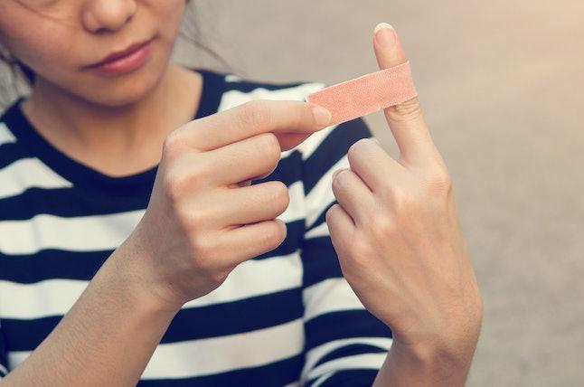 Close up bandage on an injured finger, outdoor.