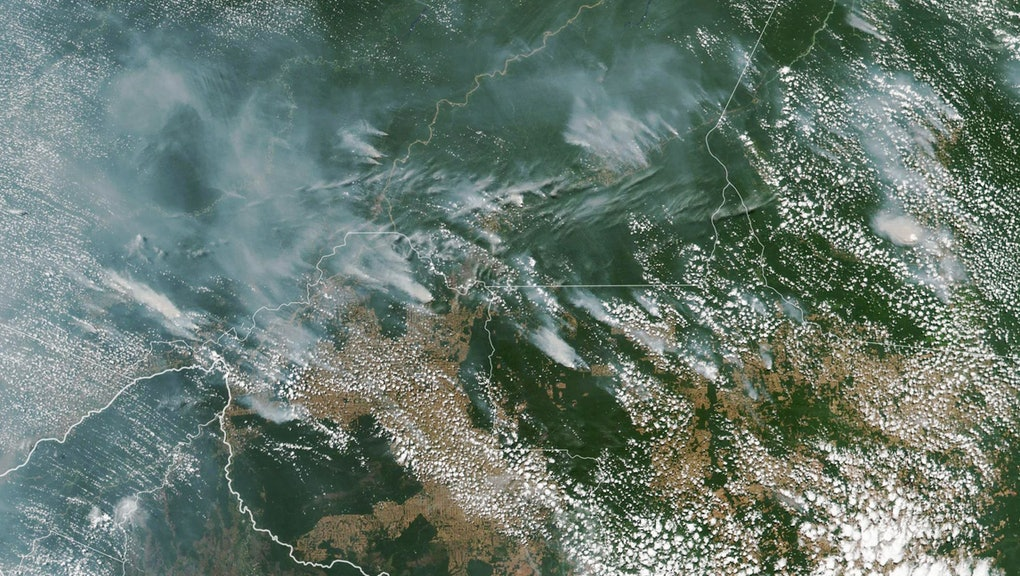 A handout photo made available by NASA of a satellite image showing several fires burning in the Brazilian states of Amazonas (top C-L), Para (top R), Mato Grosso (bottom R) and Rondonia (bottom C), 13 August 2019 (issued 21 August 2019). In picture at bottom left is seen Bolivia. In the Amazon region, fires are rare for much of the year because wet weather prevents them from starting and spreading. However, in July and August, activity typically increases due to the arrival of the dry season. Many people use fire to maintain farmland and pastures or to clear land for other purposes.