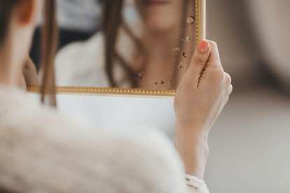 beautiful bride looks in the mirror