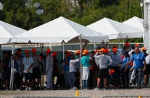 Migrant children stand outside the Homestead Temporary Shelter for Unaccompanied Children, in Homest...
