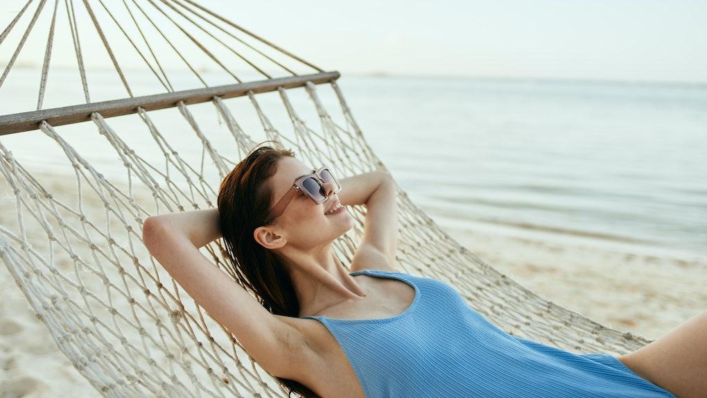 Swimsuit vacation woman hammock sand sea ocean