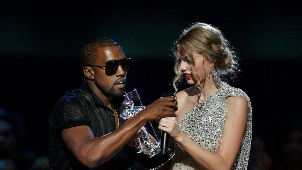"Kanye West, Taylor Swift. Singer Kanye West takes the microphone from singer Taylor Swift as she accepts the ""Best Female Video"" award during the MTV Video Music Awards on in New York"