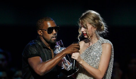 """Kanye West, Taylor Swift. Singer Kanye West takes the microphone from singer Taylor Swift as she accepts the """"Best Female Video"""" award during the MTV Video Music Awards on in New York"""