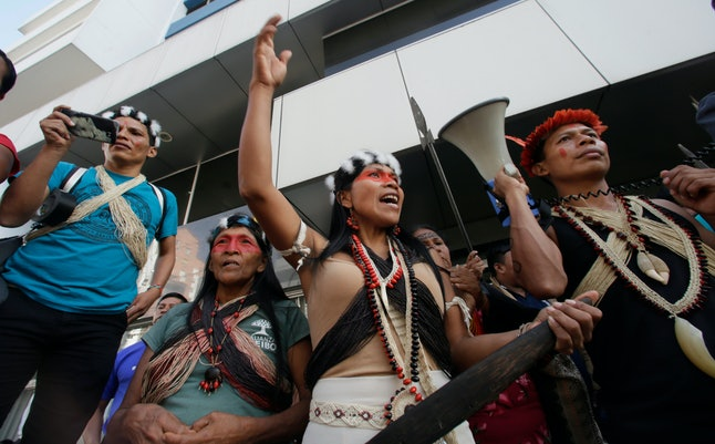 Waoranis leader Nemonte Nenkimo, center, leads a demonstration of Ecuadorian Amazon Indigenous people of different ethnic groups, in front of PetroEcuador in Quito, Ecuador, . They are demanding that the government refrain from extracting natural resources from their soil. Waoranis won an early court victory recently to stop oil extraction