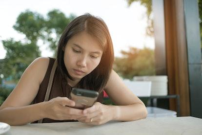 asian girl calling phone, woman use smartphone