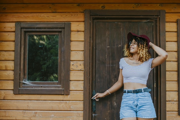 young girl modern posing in the log cabin