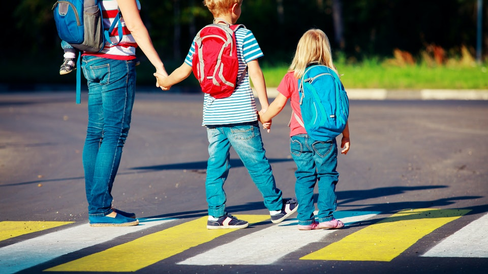 mother taking kids to school or daycare