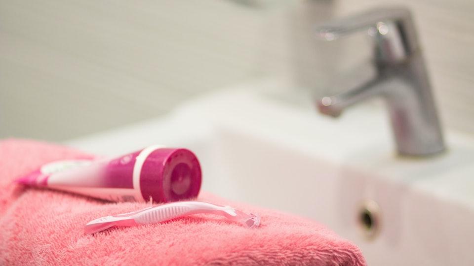 shaving tools : foam, shaver. Safety razor with shaving cream on pink bath towel, shaving procedure for face, legs, hands, bikini