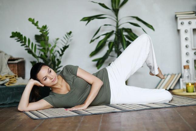 Yoga. Woman doing yoga at home