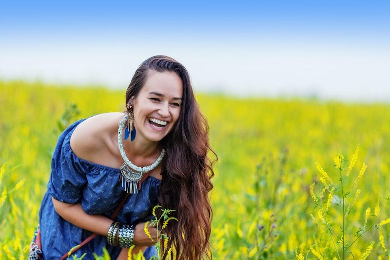 happy woman in summer meadow