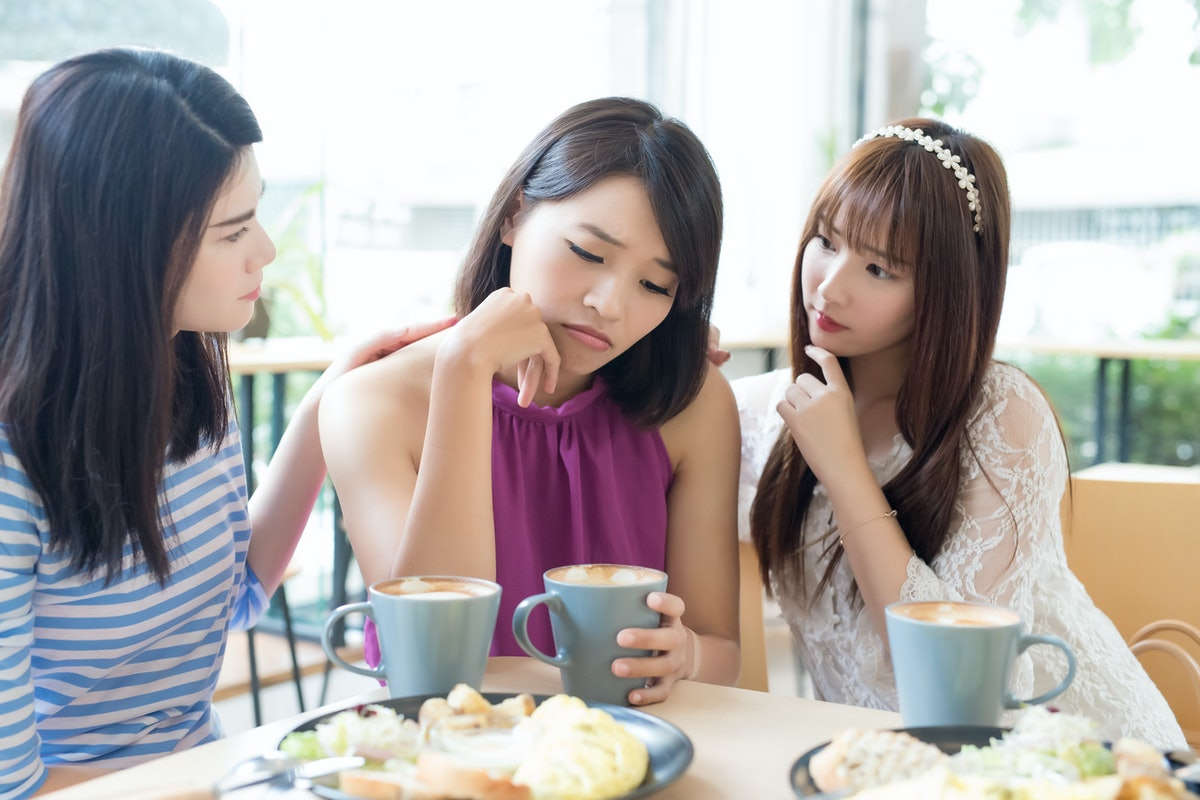 woman friends sit and feel upset in the restaurant