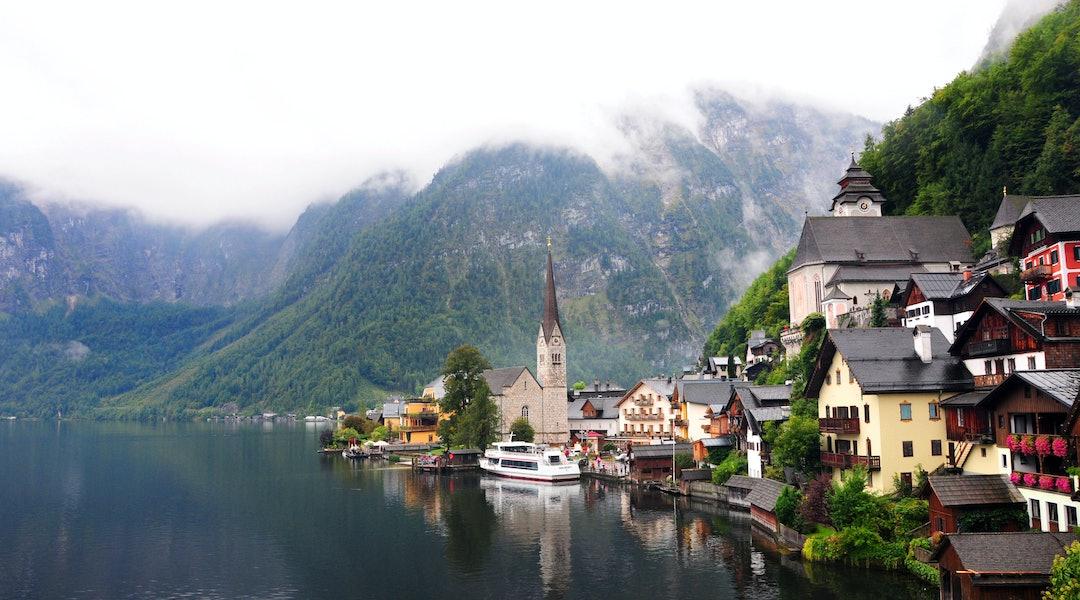 Iconic fairytale European city Hallstatt, Austria on a rainy fall day in the Austrian Alps