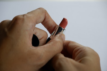 Woman with lipstick on a white background