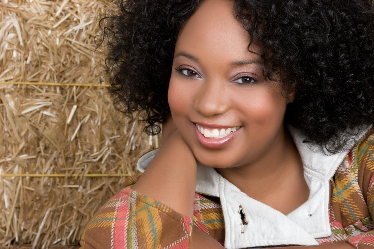 Smiling Woman in Hay