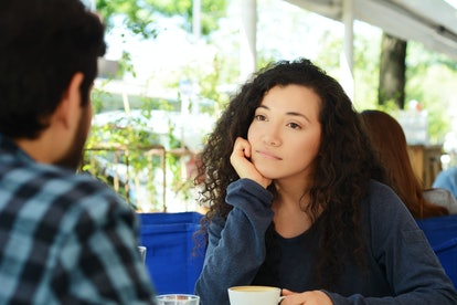 Young beautiful woman bored at a date in coffee shop.