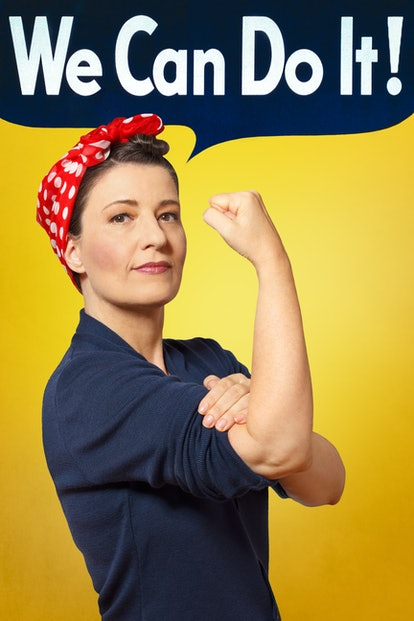 Rosie the Riveter photo with text We can do it! A self-confident woman rolling up her sleeve, perfect tribute to the classic american poster.