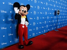 Mickey Mouse waves to members of the media at the Disney Legends press line during the 2019 D23 Expo...