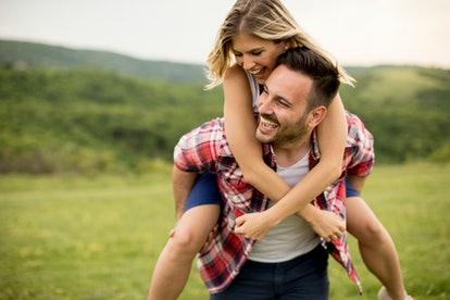 Young loving couple having fun in the spring nature