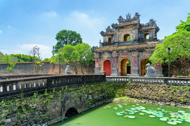 Wonderful view of the East Gate (Hien Nhon Gate) to the Citadel and a moat surrounding the Imperial City with the Purple Forbidden City in Hue, Vietnam. Hue is a popular tourist destination of Asia.