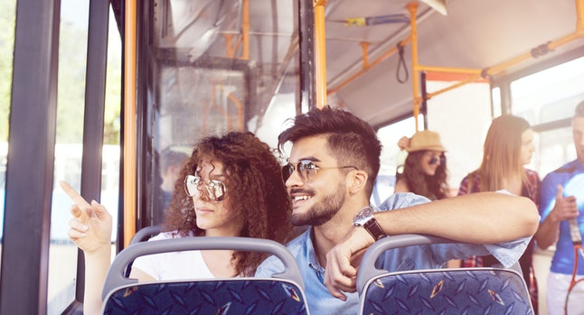 Smiling young couple in a bus.