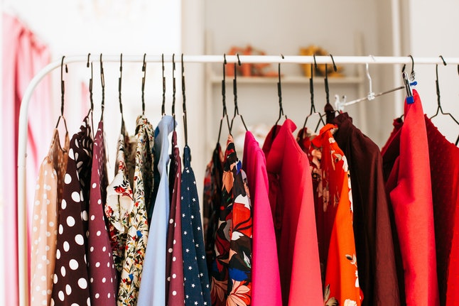 Womens dresses on hangers in a retail shop