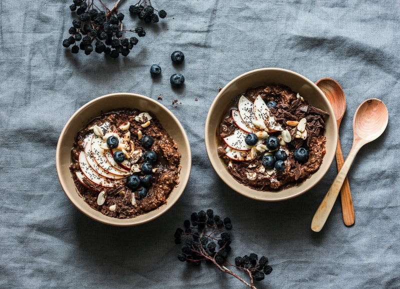 Chocolate oatmeal with apples and blueberries. Oatmeal is one of the best foods to eat to avoid acid reflux.