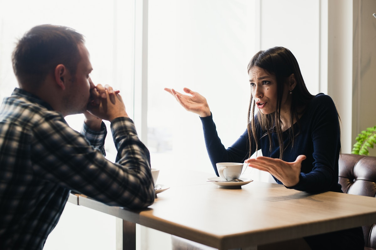 Young couple arguing in a cafe. Relationship problems.