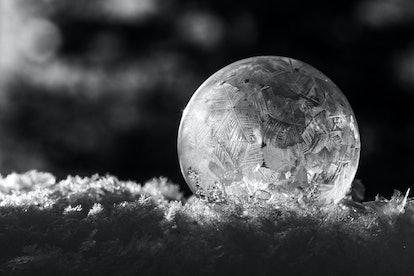 Blowing soap bubbles outside when it's below freezing can result in frozen bubbles.