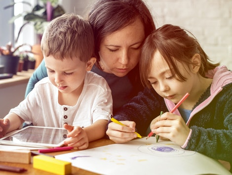 Mom and kids at homeschool learning together