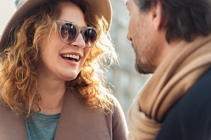 Happy couple flirting with joy