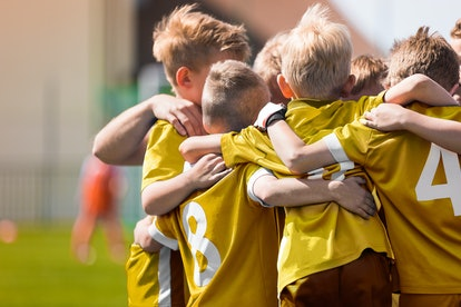 Kid Soccer Football Team Huddle. Children Play Sport Game. Children Sporty Team United Ready to Play...