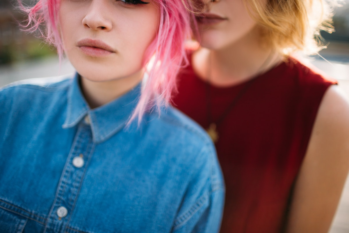 Lesbian couple. Cropped view of young girls hugging. Homosexual relationship romance.
